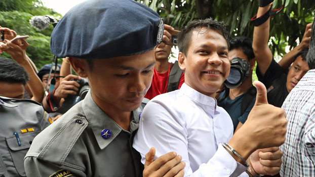 Phyo Wai Win, a reporter at Myanmar's Eleven Media Group, arrives at Insein Prison after appearing at a courthouse in Yangon's Tamwe township, Oct. 10, 2018.