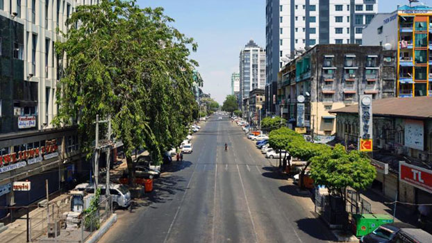 A usually busy street in Myanmar's commercial hub Yangon is devoid of pedestrians and traffic amid a lockdown to prevent the spread of COVID-19 during the Buddhist New Year, April 15, 2020.