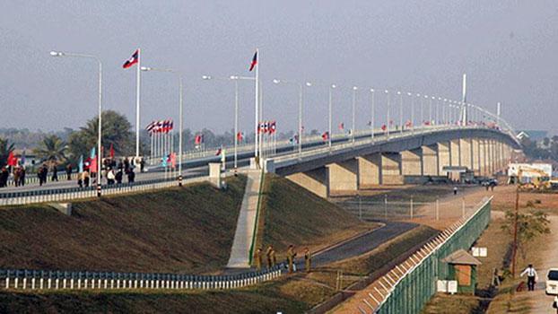 Lao citizens prepare to cross the Second Thai–Lao Friendship Bridge over the Mekong River, connecting Thailand's Mukdahan province with Laos' Savannakhet province, April 2019.