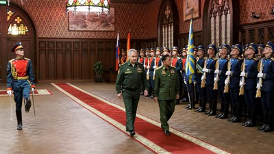 Russia's Defense Minister Sergei Shoigu (L) and Commander-in-Chief of Myanmar's Armed Forces Senior General Min Aung Hlaing (R) review an honor guard in Moscow, June 23, 2021.