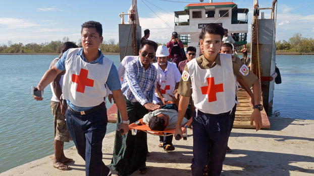 Injured people from Kyauktan village in Rathedaung township are carried on stretchers as they arrive in Sittwe, capital of western Myanmar's Rakhine state, May 2, 2019.
