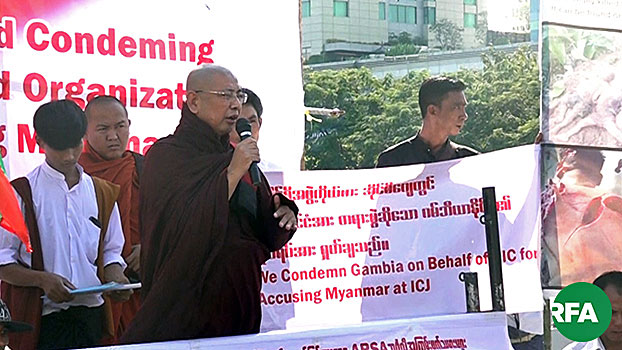 Myanmar former Buddhist abbot Parmaukkha speaks to nationalist activists during a protest against the Organization of Islamic States and a lawsuit against Myanmar at the International Court of Justice, in Yangon, Nov. 25, 2019.