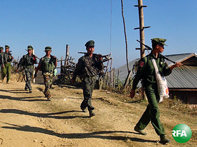 Soldiers from the Ta'ang National Liberation Army patrol a village in eastern Myanmar's Shan state in an undated photo.
