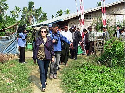 Yanghee Lee (C), the U.N.'s special envoy on human rights in Myanmar, leaves a camp for internally displaced persons in Myebon township in western Myanmar's Rakhine state, Jan. 9, 2015. Credit: AFP