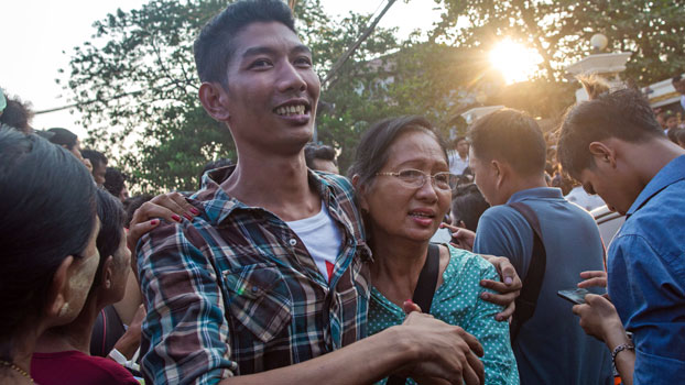 A Myanmar woman (R) greets her son (L) after he is released from Insein Prison as part of a presidential amnesty for prisoners during the Buddhist New Year, in Yangon, April 17, 2019.