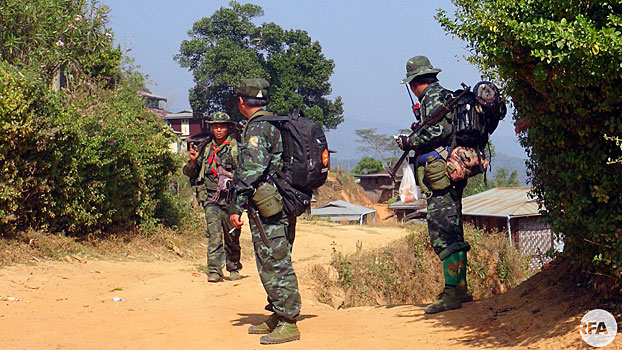 Soldiers from the Restoration Council of Shan State/Shan State Army-South pass through a village in Myanmar's Shan state in an undated photo.