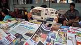 myanmar-man-reading-the-voice-newspaper-yangon-apr1-2013.jpg