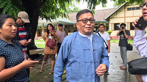 Rev. Hkalam Samson (C) of the Kachin Baptist Convention leaves Myitkyina Township Court in Myitkyina, capital of northern Myanmar's Kachin state, Sept. 9, 2019.