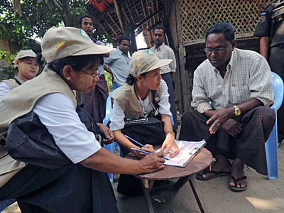 An ethnic Kaman man (R) answers questions as census enumerators take data in Bumay village on the outskirts of Sittwe, western Myanmar's Rakhine state, March 31, 2014.
