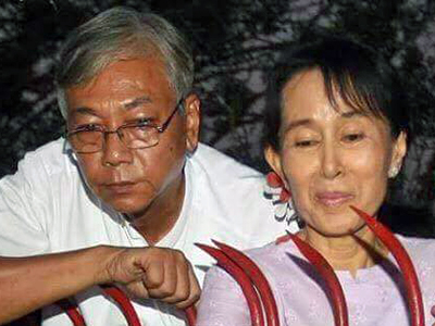 Htin Kyaw and Aung San Suu Kyi in the mid-1990s, when he represented her while she was under house arrest. Credit: RFA