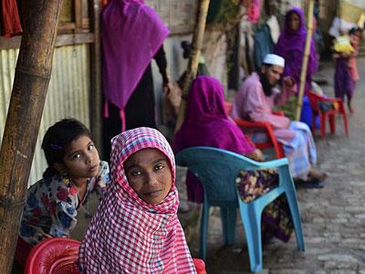 Myanmar Rohingya refugees sit in a refugee camp in Teknaf in Bangladesh's Cox's Bazar, Nov. 26, 2016.