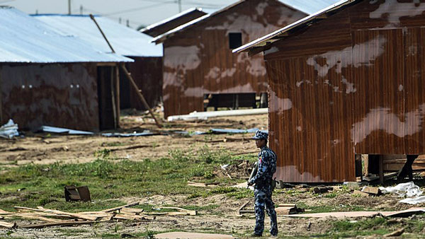 A Myanmar border police officer secures the Hla Pho Khaung processing camp for Rohingya Muslims refugees near the Bangladesh border in Maungdaw township, western Myanmar's Rakhine state, April 24, 2018.