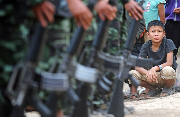 myanmar-boy-knu-soldiers-jan30-2012.jpg