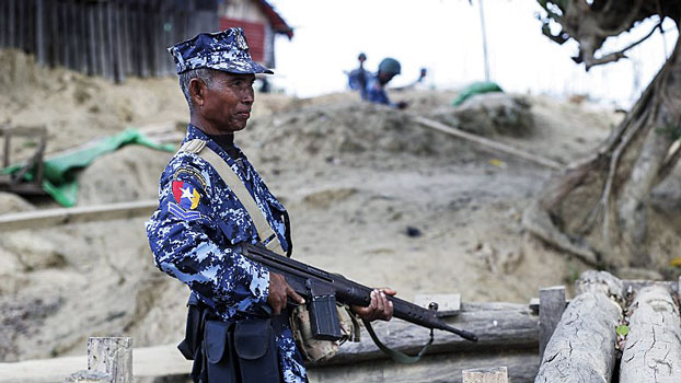 A Myanmar border guard policeman guards a police outpost in Buthidaung township, amid a surge of violence in western Myanmar's Rakhine state, Jan. 7, 2019.