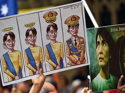 Posters referring to Myanmar's State Counselor Aung San Suu Kyi are displayed at a demonstration during the ASEAN-Australia Special Summit in Sydney, March 17, 2018.