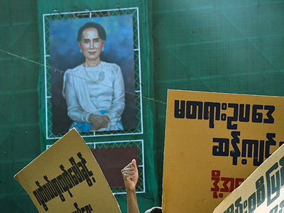 A portrait of Myanmar State Counselor Aung San Suu Kyi is seen as activists demonstrate against what they say are repressive proposed amendments to the country's Peaceful Assembly and Procession Law, in Yangon, March 5, 2018.