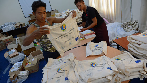 Workers prepare election paraphernalia at Myanmar's Union Election Commission headquarters in Naypyidaw, Oct. 27, 2015, in preparation for Nov. 8 general elections.