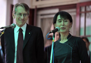 Aung San Suu Kyi speaks to reporters with Giulio Terzi at her residence in Rangoon, April 26, 2012.