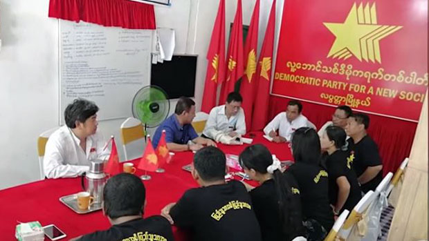 Members of the Democratic Party for a New Society hold a meeting at the party's headquarters in Myanmar's commercial hub Yangon, September 2020.