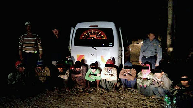 Police arrest 10 Rohingya Muslims from Rakhine state traveling illegally with two human traffickers in the town of Thayetin in Mindon township, central Myanmar's Magway region, Feb. 4, 2019.