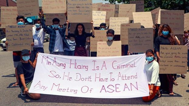 myanmar-protesters-asean-signs-yangon-arp20-2021.jpg