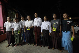 Unidentified political prisoners pose for pictures after their release from detention in Rangoon, Sept. 17, 2012.