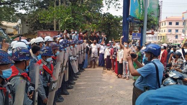 myanmar-police-block-protesters-magway-feb19-2021.jpg