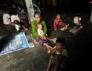 A Rakhine family at a temporary shelter in Sittwe for those displaced by violence, June 15, 2012.