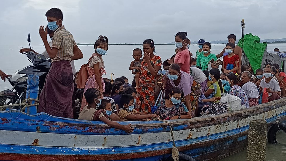 A boat carrying villagers fleeing conflict in Myanmar's Rakhine State at the state capital Sittwe, Sept 23, 2020