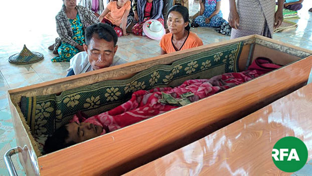 Relatives of Hla Maung Win hold a funeral for the deceased farm worker in Mrauk-U township, western Myanmar's Rakhine state, March 14, 2019.