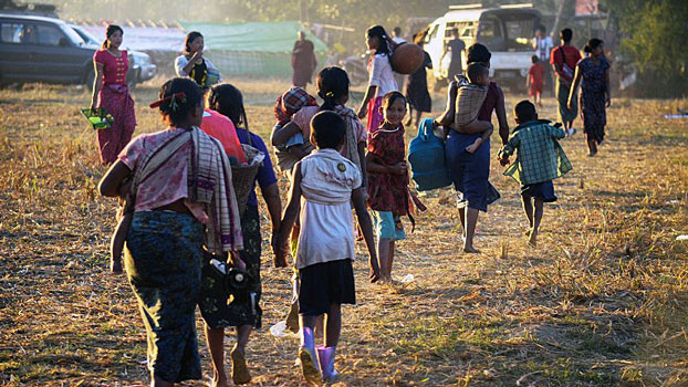 Civilians displaced by violence between ethnic Rakhine rebels and Myanmar's army arrive at a camp in Kyauktaw township, western Myanmar's Rakhine state, Jan. 4, 2019.