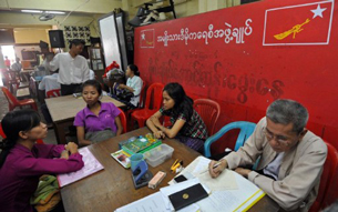 NLD members work at the party headquarters in Rangoon, Dec. 13, 2011.
