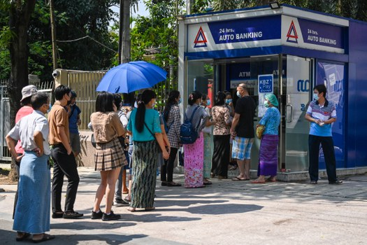 People queue as they wait to use ATMs in Yangon, April 7, 2021. AFP
