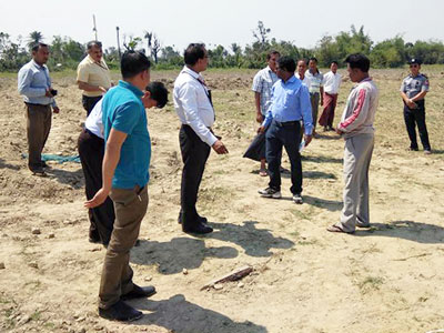 Diplomats from the Indian embassy in Myanmar survey land where their government will build homes for ethnic minorities in Maungdaw township in western Myanmar's Rakhine state, Feb. 10, 2018.