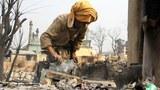 burma-meikhtila-woman-march-2013.jpg