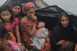 A group of Rohingya refugees fleeing violence in Burma's Rakhine state attempt to cross the Naf river into Bangladesh, June 13, 2012.