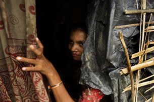 A Rohingya asylum-seeker waits for help in Kutupalong, Bangladesh, Sept. 11, 2009.