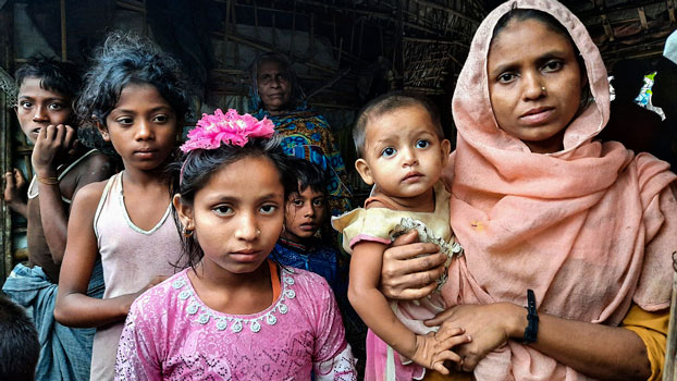 Taslima Akter (front L), a nine-year-old Rohingya girl, stands beside her mother at the Baharchara refugee camp in Cox's Bazar district, southeastern Bangladesh, Aug. 16, 2020.