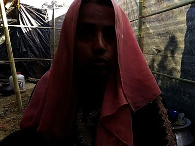 A Rohingya Muslim woman discusses a sexual assault by Myanmar security forces during a crackdown in northern Rakhine state, at Kutupalong refugee camp in Cox's Bazar, southeastern Bangladesh, Jan. 14, 2017. This photograph has been darkened to protect her identity.