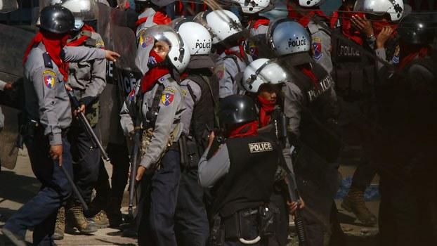 myanmar-police-after-dispersing-protest-sanchaung-yangon-mar5-2021.jpg