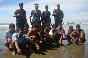 Rohingya survivors are seen in the custody of Bangladeshi border guards in Teknaf, Nov. 7, 2012.