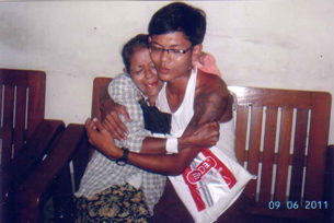 Phyo Sithu, a former child soldier in the Burmese military, with his mother following his release from prison, Sept. 2, 2011.