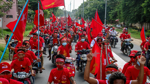 Supporters of the National League for Democracy party ride in a campaign rally motorcade through the town of Wundwin in central Myanmar's Mandalay region, Sept. 19, 2020.