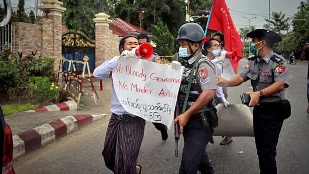 Police arrest three students protesting against the armed conflict in western Myanmar's Rakhine state, in the state capital Sittwe, Sept. 11, 2020.