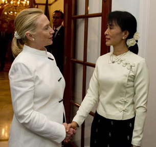 U.S. Secretary of State Hillary Clinton and Aung San Suu Kyi meet in Rangoon, Dec. 1, 2011.
