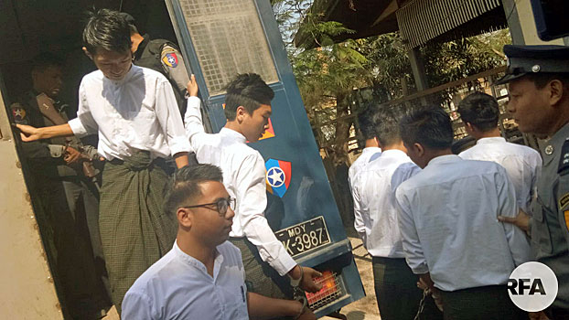 Myanmar students from Yadanabon University arrive for their trial on charges of arson and protesting without official permission at a courthouse in Amarapura township, central Myanmar's Mandalay region, Feb. 13, 2019.