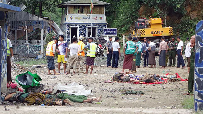Bodies are seen on the ground at the Gote Twin Bridge police outpost in Nawngkhio township, Myanmar's northern Shan state, following an attack by ethnic rebel groups, Aug 15, 2019.