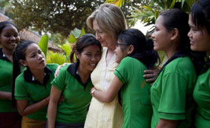 Girls hug Secretary of State Hillary Clinton at a shelter for sex trafficking victims in Cambodia, Oct. 31, 2010.