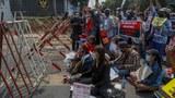 Demonstrators gather outside the Indonesian Embassy in Yangon, Myanmar, Feb. 23, 2021.