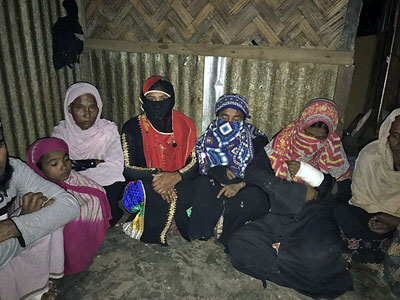Rohingya Muslim women, sheltered in a house at Kutupalang Rohingya camp in Bangladesh, talk about the abuse they endured during security operations in western Myanmar's Rakhine state, Jan. 27, 2017.